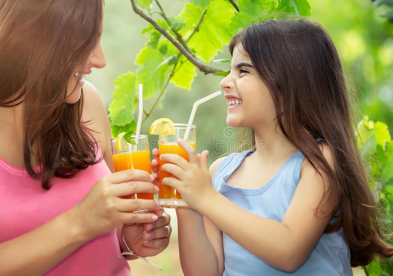 Happy family drinking juice royalty free stock images
