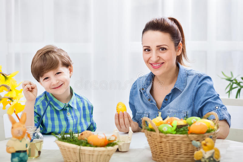 Happy family in easter time stock photos