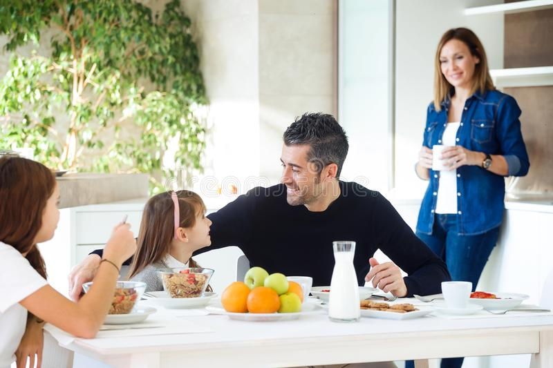 Happy family eating breakfast and having fun in kitchen table at home royalty free stock image
