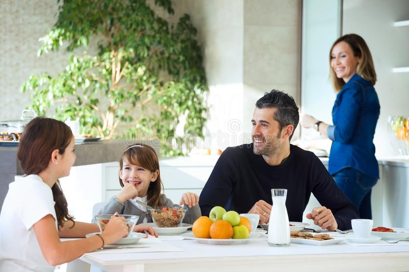 Happy family eating breakfast and having fun in kitchen table at home. Shot of happy family eating breakfast and having fun in kitchen table at home royalty free stock images