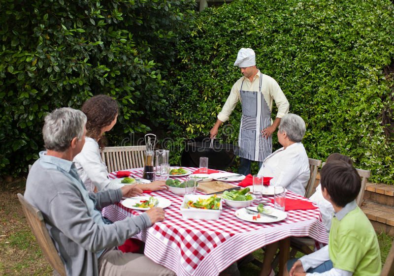 Happy family eating in the garden. Durring the summer royalty free stock photo