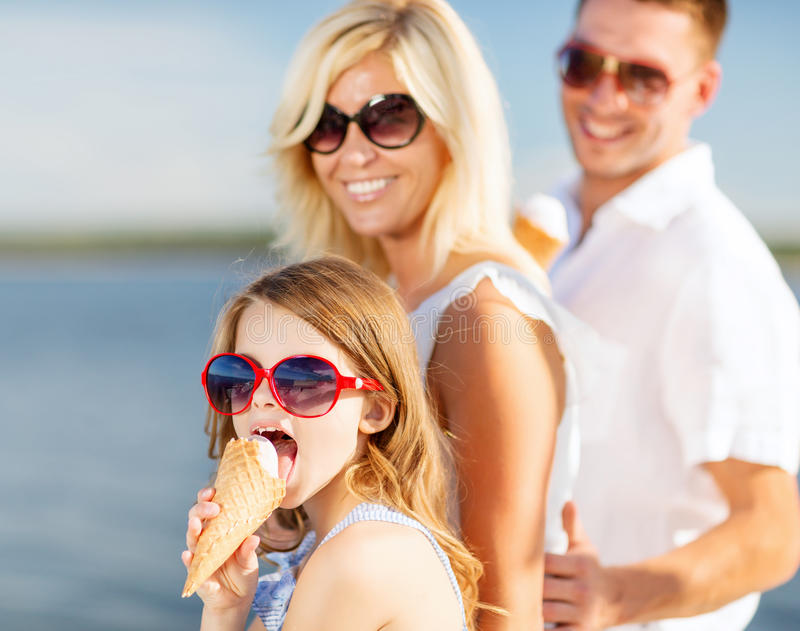Happy family eating ice cream. Summer holidays, celebration, children and people concept - happy family eating ice cream stock photos