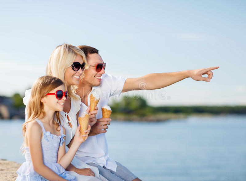 Happy family eating ice cream. Summer holidays, celebration, children and people concept - happy family eating ice cream royalty free stock photography