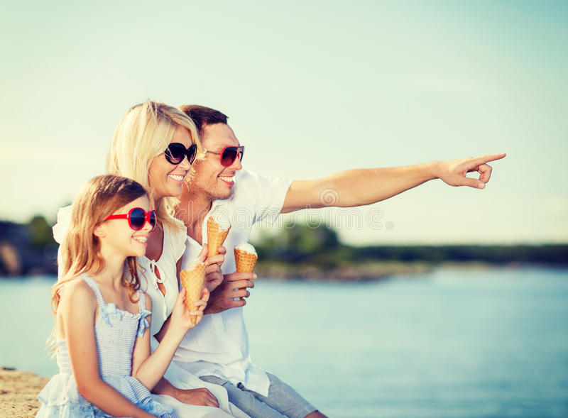 Happy family eating ice cream. Summer holidays, celebration, children and people concept - happy family eating ice cream royalty free stock photos