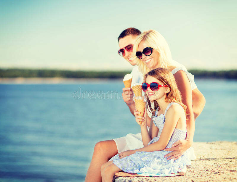 Happy family eating ice cream. Summer holidays, celebration, children and people concept - happy family eating ice cream stock image