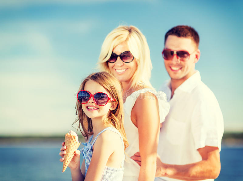 Happy family eating ice cream. Summer holidays, celebration, children and people concept - happy family eating ice cream stock photography