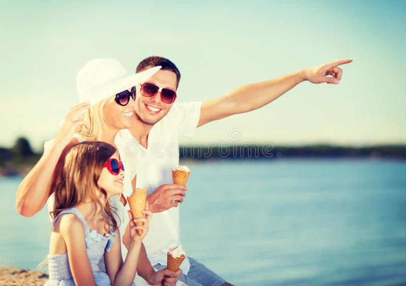 Happy family eating ice cream. Summer holidays, celebration, children and people concept - happy family eating ice cream royalty free stock image