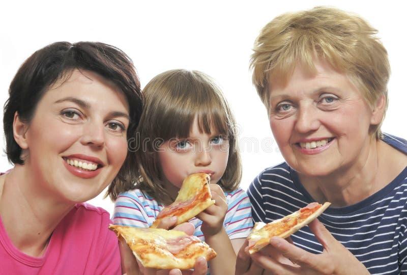 Happy family eating pizza. White background royalty free stock photos