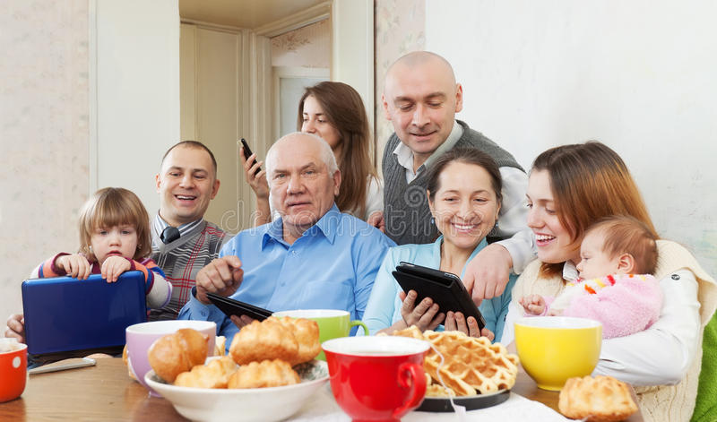 Happy family with electronic devices royalty free stock photos