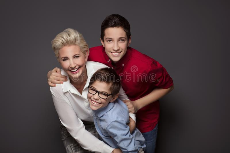 Happy mother posing with two sons. royalty free stock photos