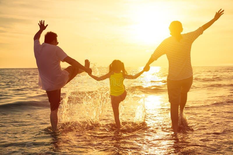 Happy family enjoy summer vacation. On the beach royalty free stock photos