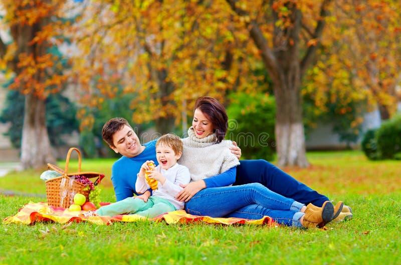 Happy family enjoying autumn picnic. In city park stock images