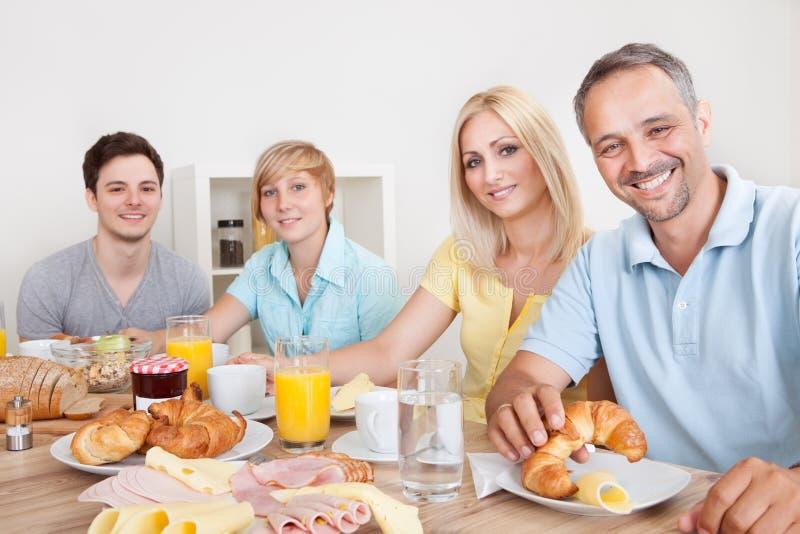 Happy family enjoying breakfast stock photos