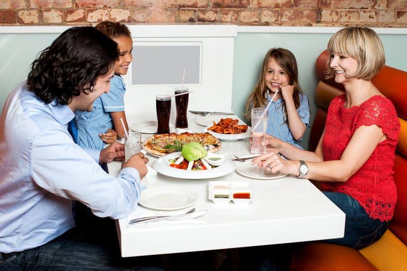 Happy family enjoying dinner stock images