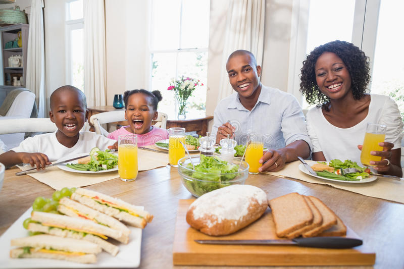 Happy family enjoying a healthy meal together stock image