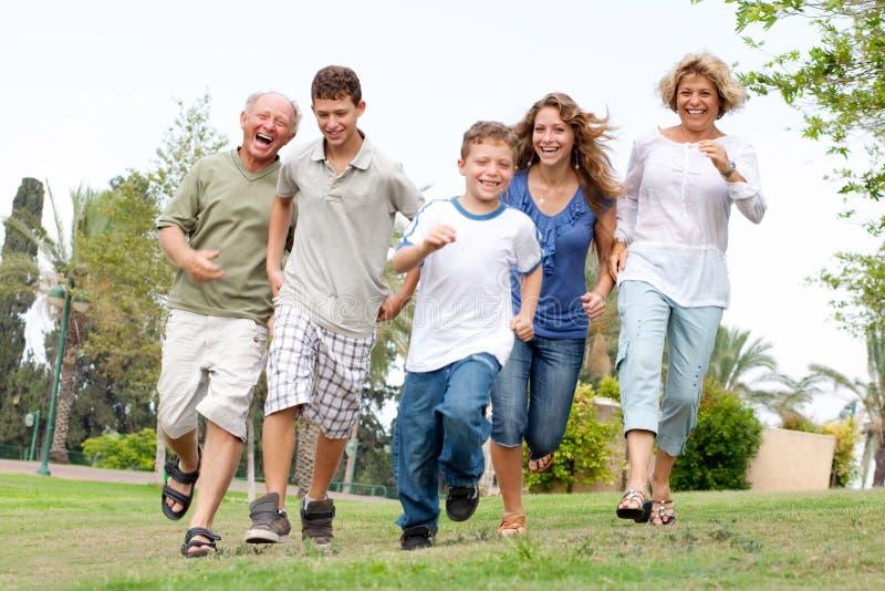 Happy family enjoying outdoors royalty free stock photo