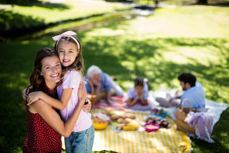 Happy family enjoying in park royalty free stock image