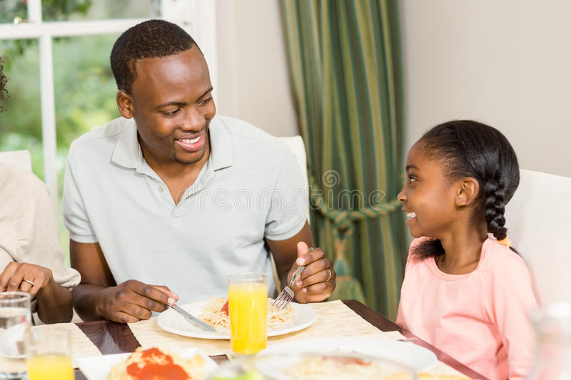 Happy family enjoying their meal royalty free stock image