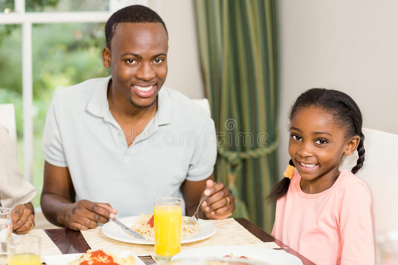 Happy family enjoying their meal royalty free stock photography