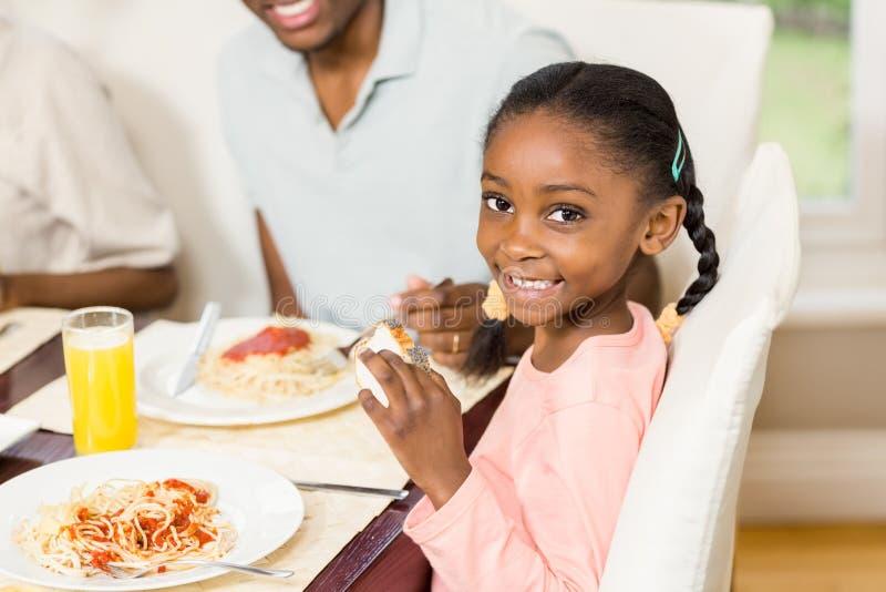 Happy family enjoying their meal royalty free stock photo