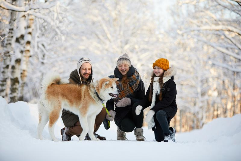 Happy Family Enjoying Walk with Dog stock photos