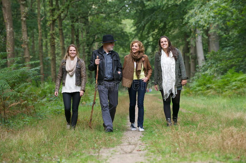 Happy family enjoying a walk in the forest royalty free stock images