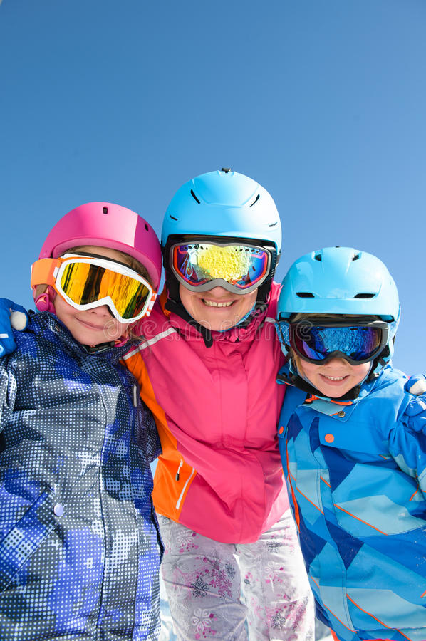 Happy family enjoying winter vacations in mountains . Ski, sun, snow and fun royalty free stock photo