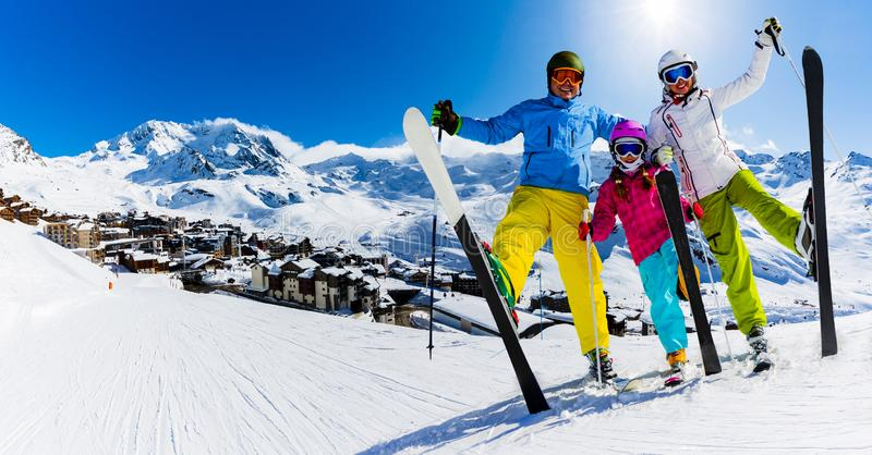Happy family enjoying winter vacations in mountains, Val Thorens, 3 Valleys, France. Playing with snow and sun in high mountains. stock photos