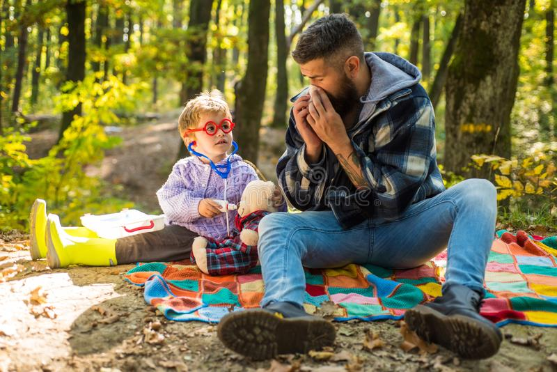 Parent teach baby. Happy family, father and baby son playing and laughing on autumn walk. Father playing with little son. Happy family, father and baby son royalty free stock images