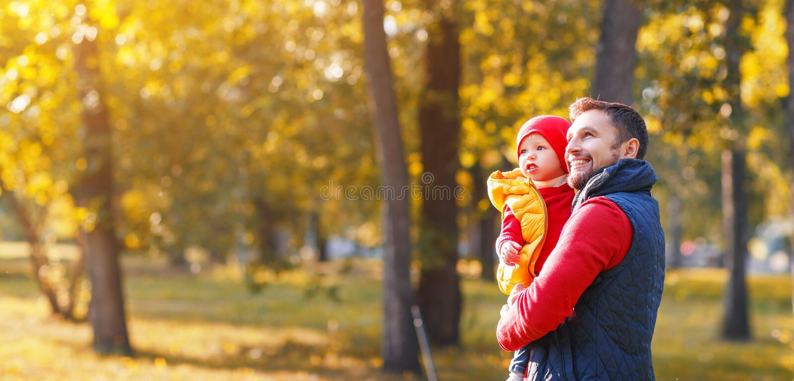 Happy family father and baby son on autumn walk. Happy family father and baby son playing and laughing on autumn walk royalty free stock images