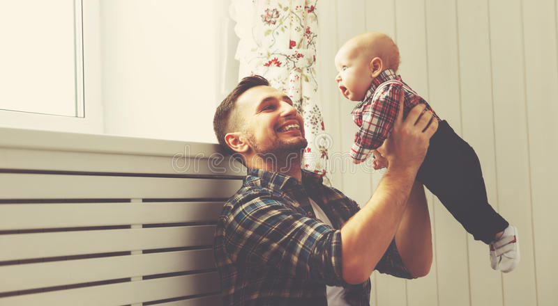 Happy family father and child baby son playing at home stock image