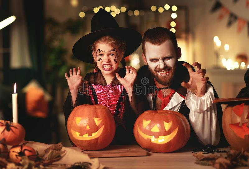 Happy family   father and child daughter in costumes and makeup on  Halloween. Happy family mother father and child daughter in costumes and makeup on a royalty free stock images