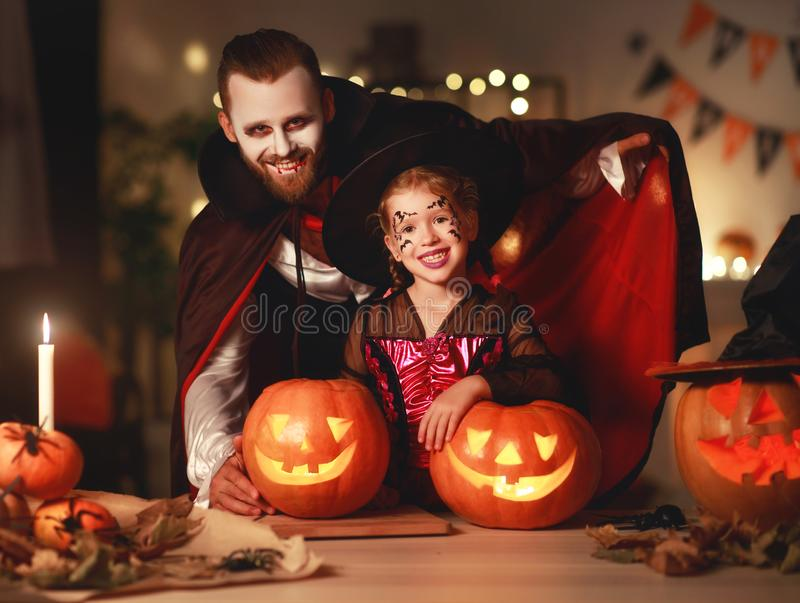 Happy family   father and child daughter in costumes and makeup on  Halloween. Happy family mother father and child daughter in costumes and makeup on a stock images