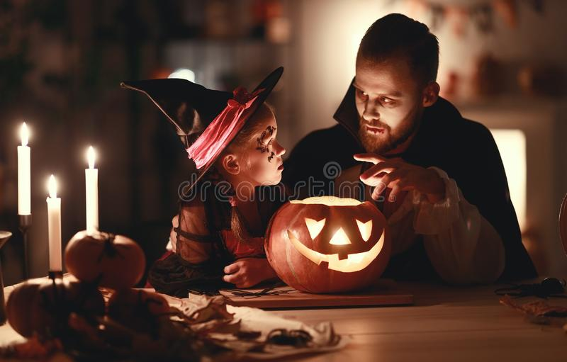 Happy family   father and child daughter in costumes and makeup on  Halloween stock photography