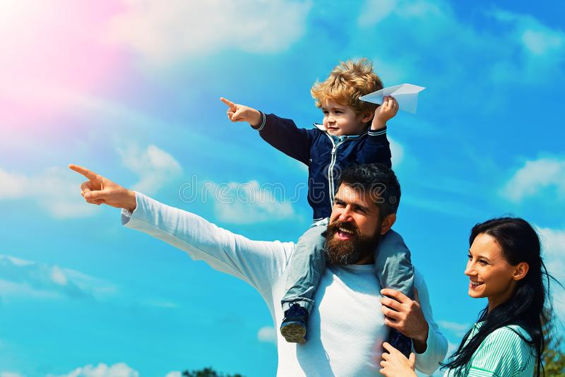 Happy family father and child on meadow with a kite in the summer on the nature. Enjoy. Happy family - child son playing royalty free stock photo