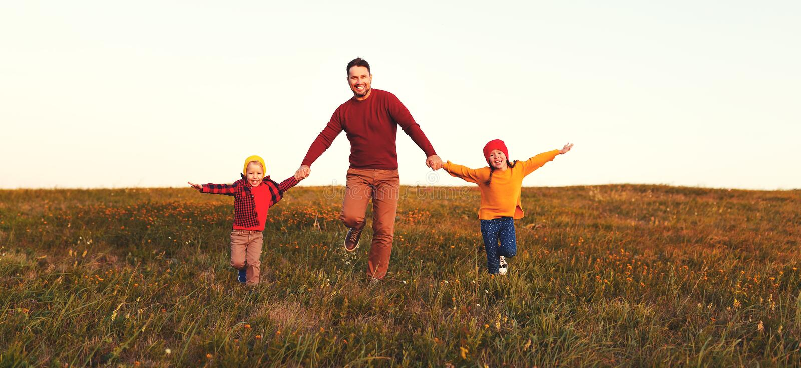 Happy family father and children in autumn nature at sunset royalty free stock image