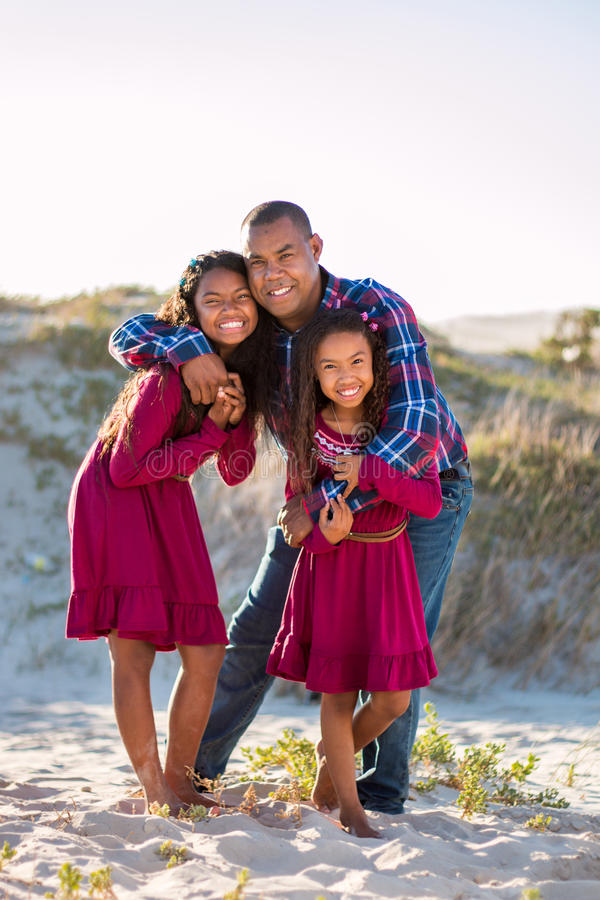 Happy family, father and daughters full length portrait outdoors royalty free stock photography
