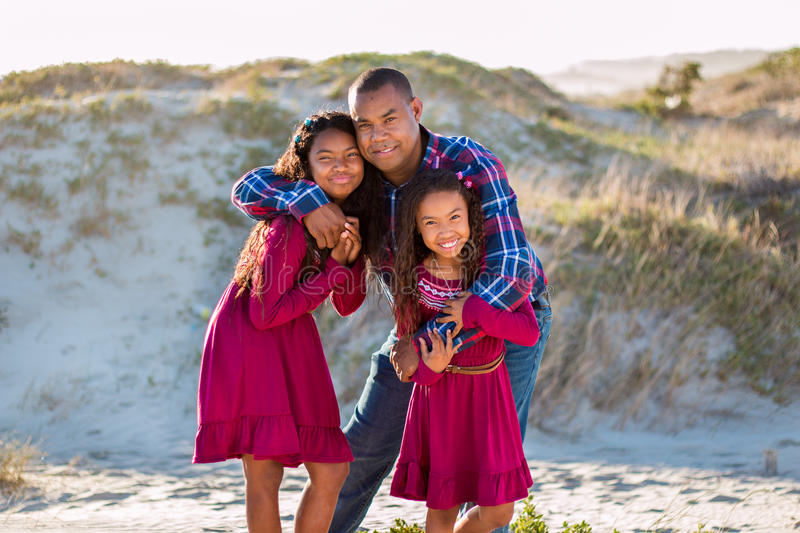 Happy family, father and daughters portrait stock photo