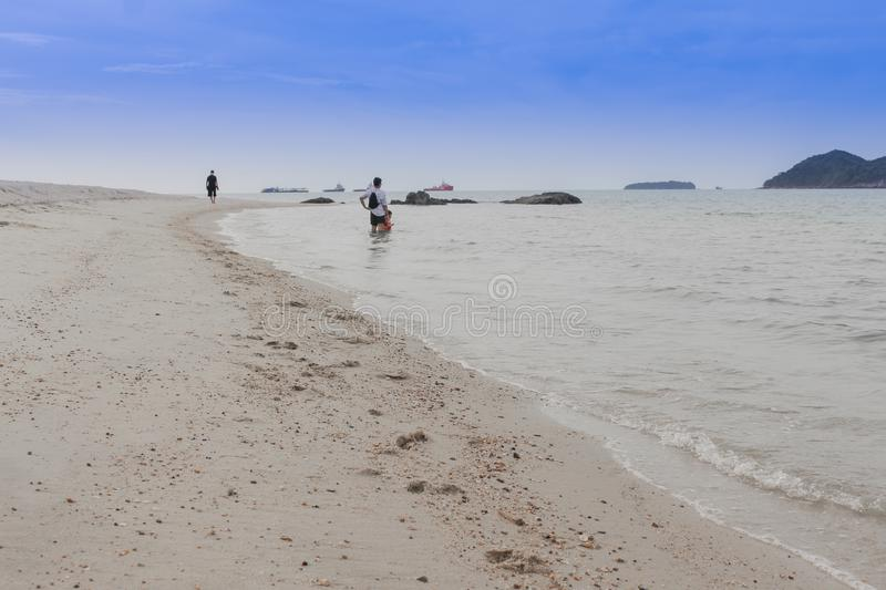 Happy family - father hold baby hand walk in sea on summer vacations with children royalty free stock photography