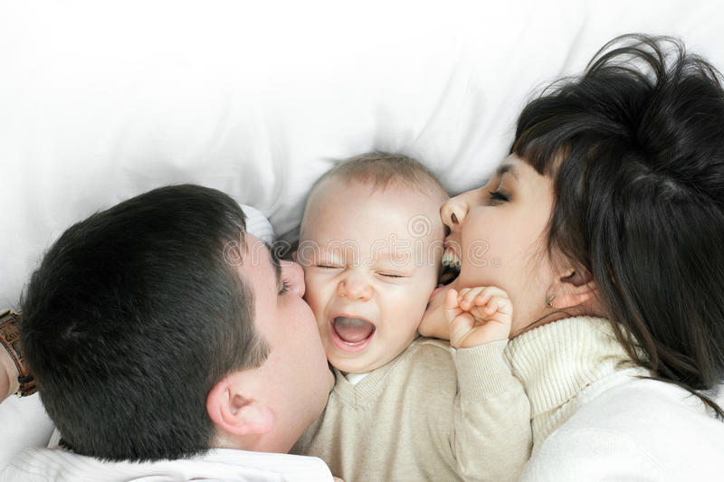 Happy family - father, mother and baby stock image