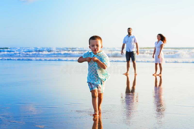 Happy family have fun on sunset beach royalty free stock photography