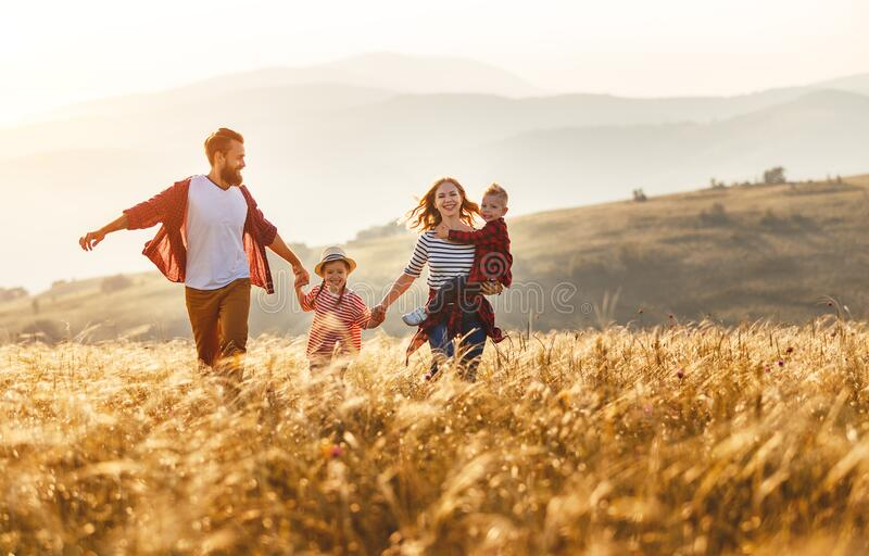 Happy family father of mother and child son  on nature royalty free stock image