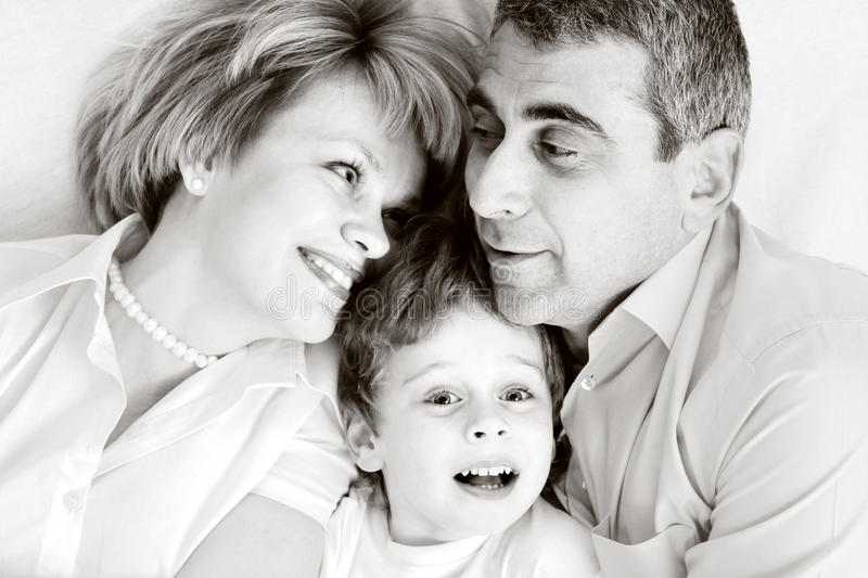 Happy family - father, mother and son stock photography