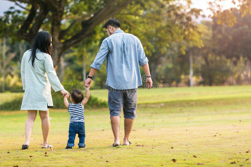Happy family father mother and son playing outdoors in the garden. stock photography