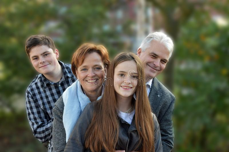 We are a happy family, father mother and two teenagers stock photography
