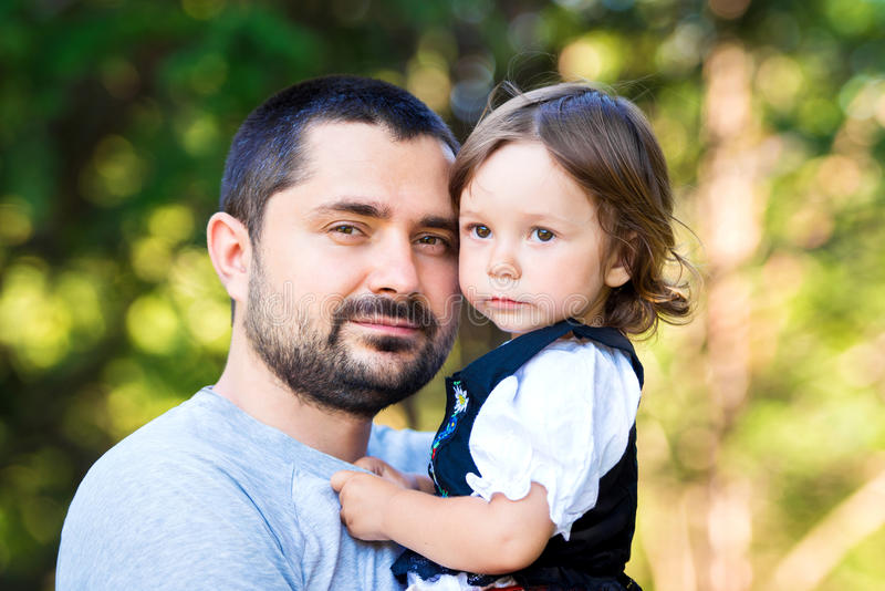 Happy family and father`s day. child daughter kissing and hugging dad stock photos