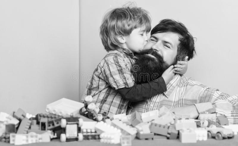 Happy family. Father and son have fun with bricks. Child development and upbringing. Bearded hipster and boy play. Together. Happy childhood. Dad and child stock photos