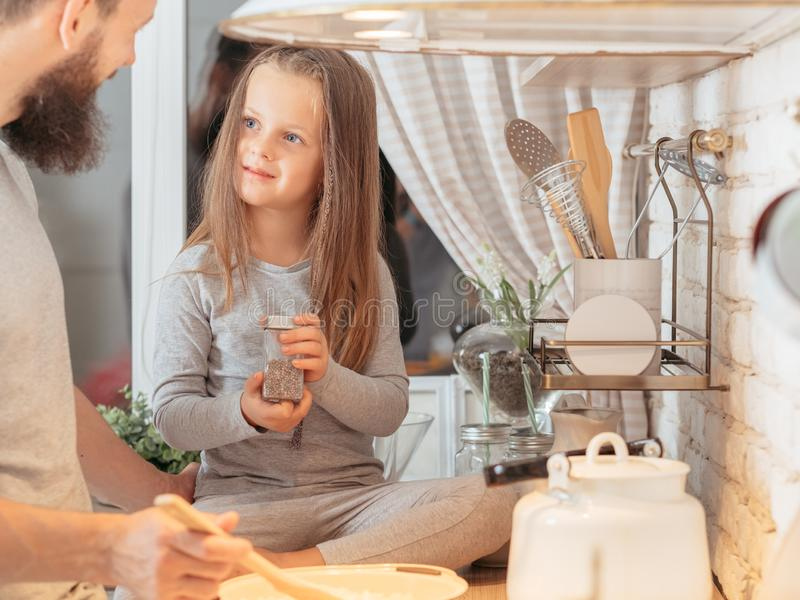 Happy family father daughter teaching cooking stock photography