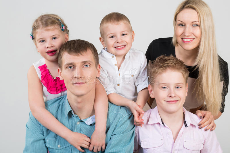 Happy family of five people stock images