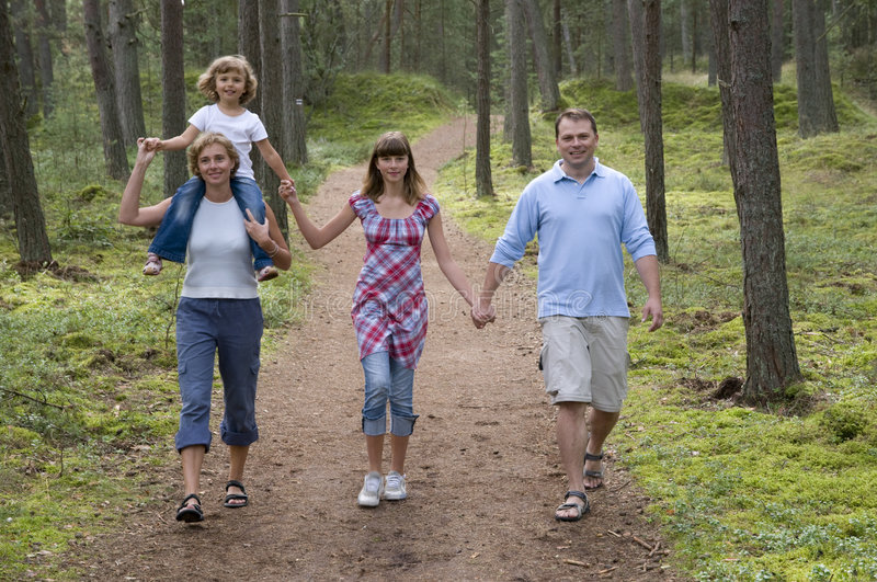 Happy family in the forest stock photos